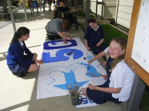 MAC team green painting the 350 banner